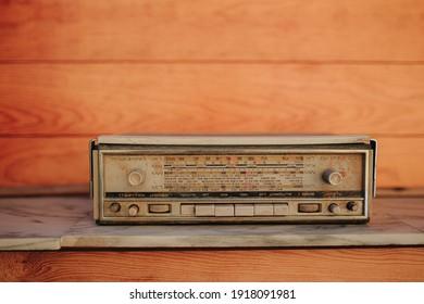 Vintage radio on an orange background
