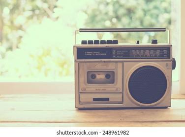 vintage radio on table nature background, instagram filter
