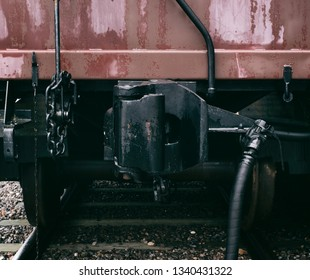 Vintage railway car coupling with desaturated look.