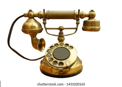 A vintage real whole brass rotation dial telephone isolated on true white background , old decades communication technology concept