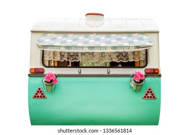 Vintage rear of a caravan in two tone green and white isolated on a white background