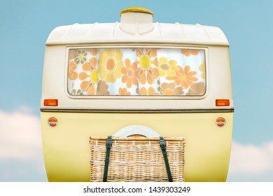 Vintage rear of a caravan in two tone yellow and white