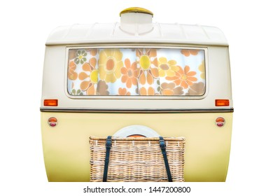 Vintage rear of a caravan in two tone yellow and white isolated on a white background