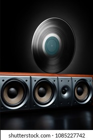 Vintage record lp rolling over a loudspeaker. Concept of music, party, club and audiophile.