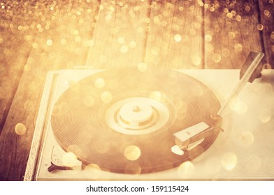 vintage record player and glitter lights