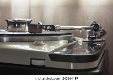 A vintage record player(turntable) with LP(record)