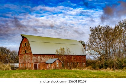 A vintage red barn and silo near West Concord, Minnesota.