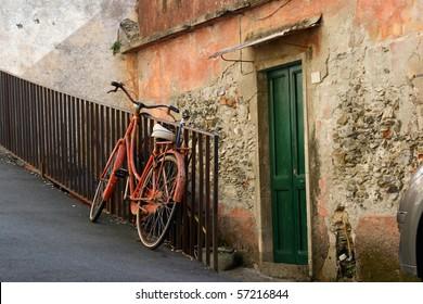 Vintage red bicycle in European village