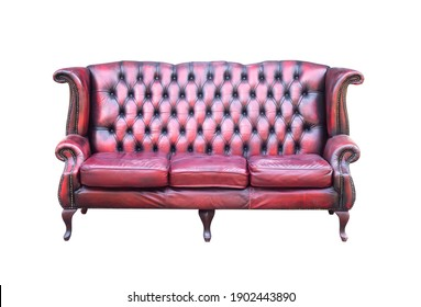 Vintage red with black sofa isolated on a white background