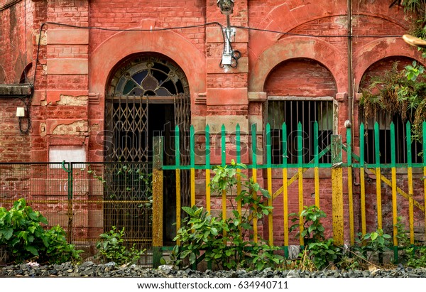 Vintage red brick house exterior with railings having an old worn out look for background content