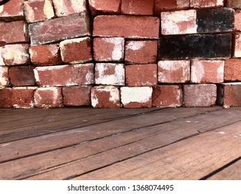 Vintage red bricks on recycled jarrah deck