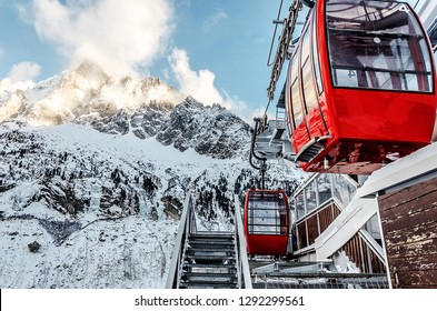 vintage red cable cars in the french alps