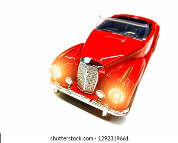 Vintage red car, turn on the headlights