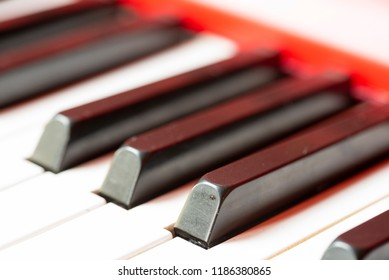 Vintage red classical grand piano. Black and white keys. The keyboard of antique key music instrument diagonal composition closeup