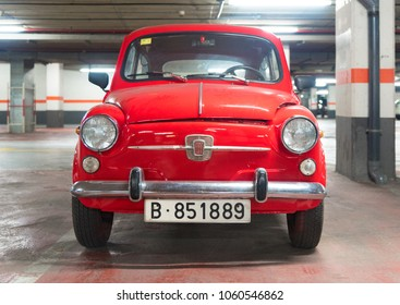 Vintage red fiat 500 tiny car in a parking in Barcelona,  2 January 2018 - Spain.