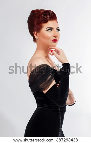 7f052d9826b0 Vintage red hair model with retro hairstyle and makeup, isolated, old  Hollywood look