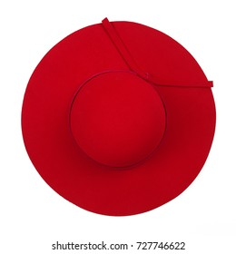 Vintage red hat on white background. Top view.