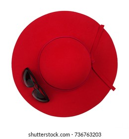 Vintage red hat and Sunglasses on white background. Top view.