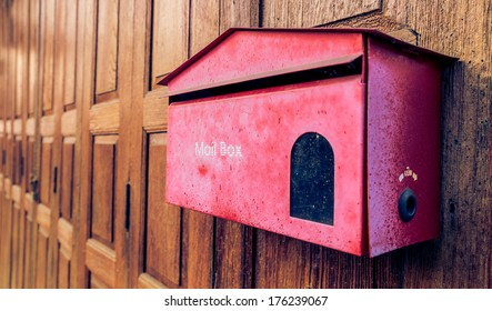 Vintage red mail box on the wood background