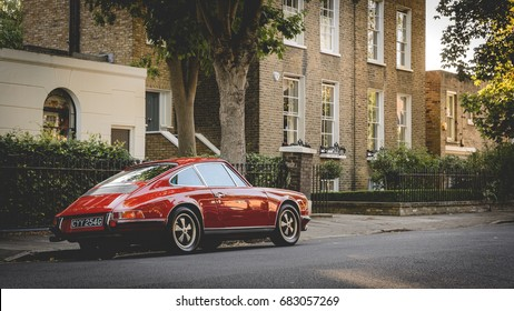 Vintage red Porsche parked in a street of Canonbury in North London (UK). July 2017.