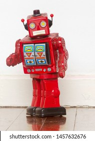 vintage red robot says hi  on old wooden floor