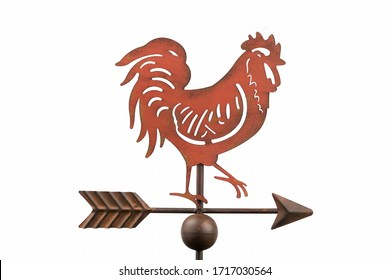 A vintage red stencil rooster weather vane is isolated on a white background.