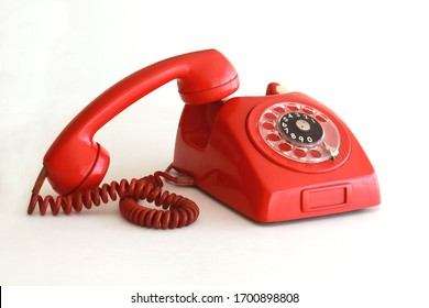 Vintage red telephone with off-hook handset