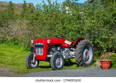 Vintage red tractor on the farm