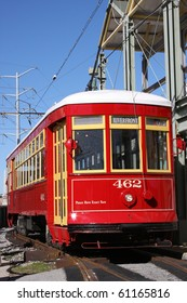 Vintage red trolley streetcar on rail in New Orleans French Quarter