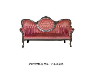 Vintage red velvet sofa isolated on white
