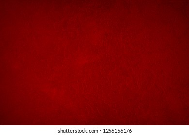 Vintage red wall texture for design background. Artistic plaster. Artistic gradient. Illuminated surface. Bright background raster image.
