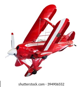Vintage red and white biplane isolated on white positioned as though banking in flight