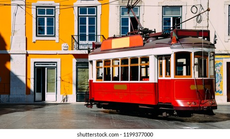 Vintage red and white tram on the street of Lisbon, Portugal, also known as eletrico or bondinho