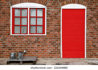 Vintage red window and red door on red brick wall