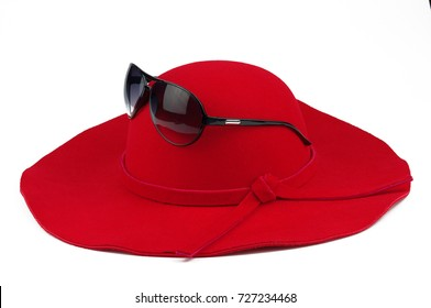 Vintage red wings hat and Sunglasses on white background.