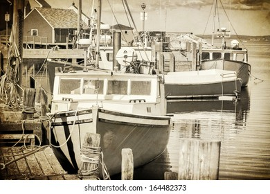 Vintage representation of fishing boats in Peggy's Cove, Nova Scotia, Canada. Gritty look with sepia toning.