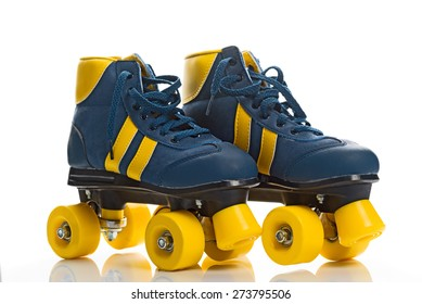 Vintage Retro Blue and Yellow Quad Roller Skates on White Background with Reflection.