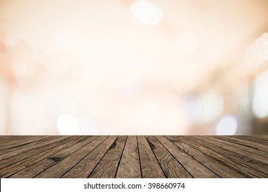 vintage retro brown wood tabletop with blurred abstract luxury bokeh light background for show advertise product on display