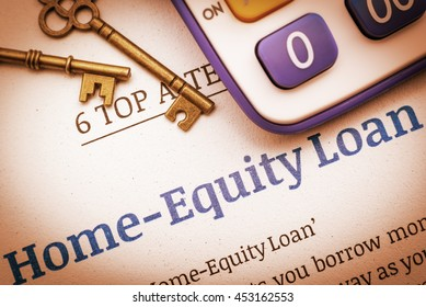 Vintage / retro color style : Two brass keys and a calculator on a home equity loan instruction document. A concept of mortgages or loans where a homeowner who want to turn their assets into cash.