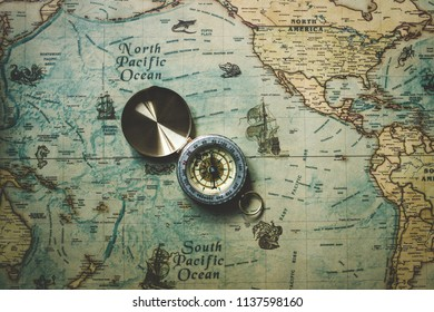 vintage retro compass on a map