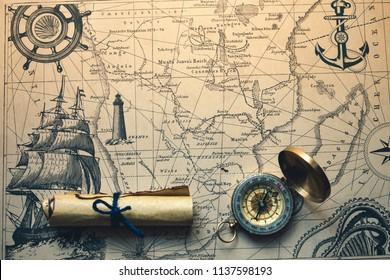 vintage retro compass on a treasure map concept