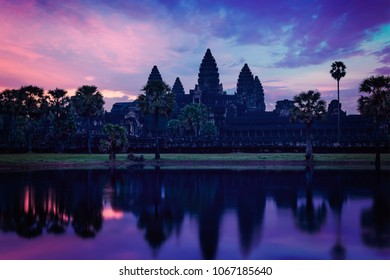 Vintage retro effect filtered hipster style image of Angkor Wat - famous Cambodian landmark - on sunrise. Siem Reap, Cambodia