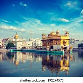 Vintage retro effect filtered hipster style travel image of Sikh gurdwara Golden Temple (Harmandir Sahib). Amritsar, Punjab, India