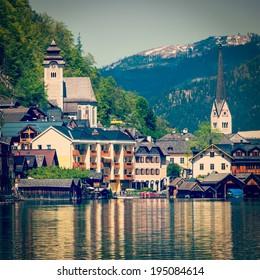 Vintage retro effect filtered hipster style travel image of Austrian tourist destination Hallstatt village on  Hallst���¤tter See in Austrian alps. Salzkammergut region, Austria