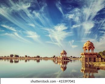 Vintage retro effect filtered hipster style image of Indian landmark Gadi Sagar - artificial lake. Jaisalmer, Rajasthan, India