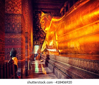 Vintage retro effect filtered hipster style image of reclining Buddha gold statue. Wat Pho, Bangkok, Thailand
