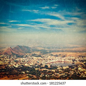 Vintage retro hipster style travel image of Holy city Pushkar aerial view from Savitri temple with grunge texture overlaid. Rajasthan, India