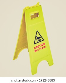 Vintage retro looking Caution wet floor and slippery surface sign - isolated over white background
