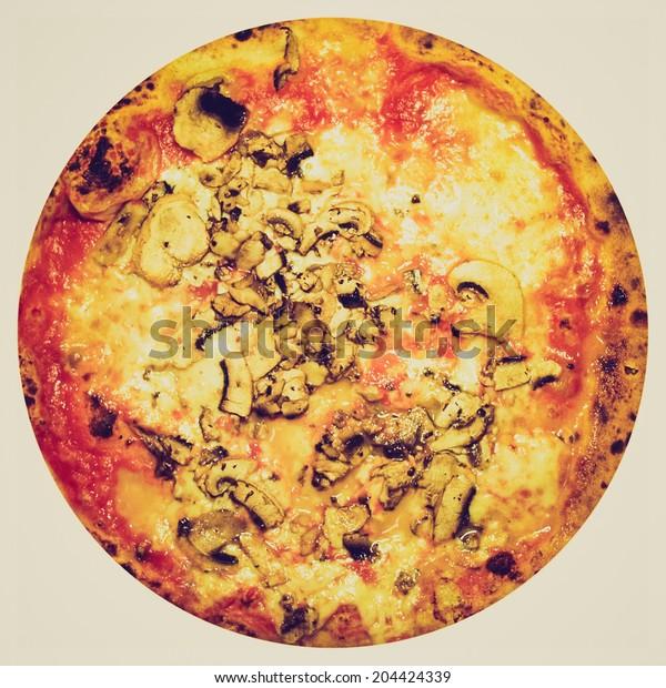 Vintage retro looking Italian mushroom pizza with tomato and Mozarella cheese