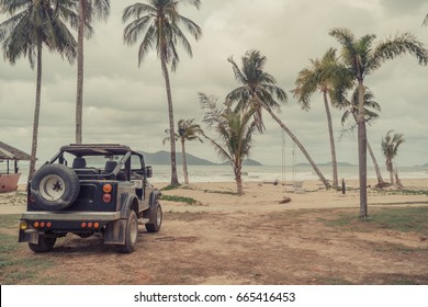 Vintage retro off road handmade car on the tropical beach. Go travel freedom concept wallpaper. Copy space.